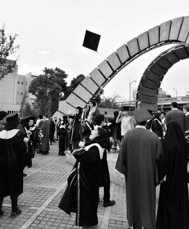 Graduation ceremony in the amir kabir university in tehran Graduation Ceremony Graduation Graduation Party  Graduating Graduate Large Group Of People People Adult Adults Only Outdoors Black & White Photography Monocrhome Black And White Collection  Happiness Happy University Student Unıversity EyeEm Selects