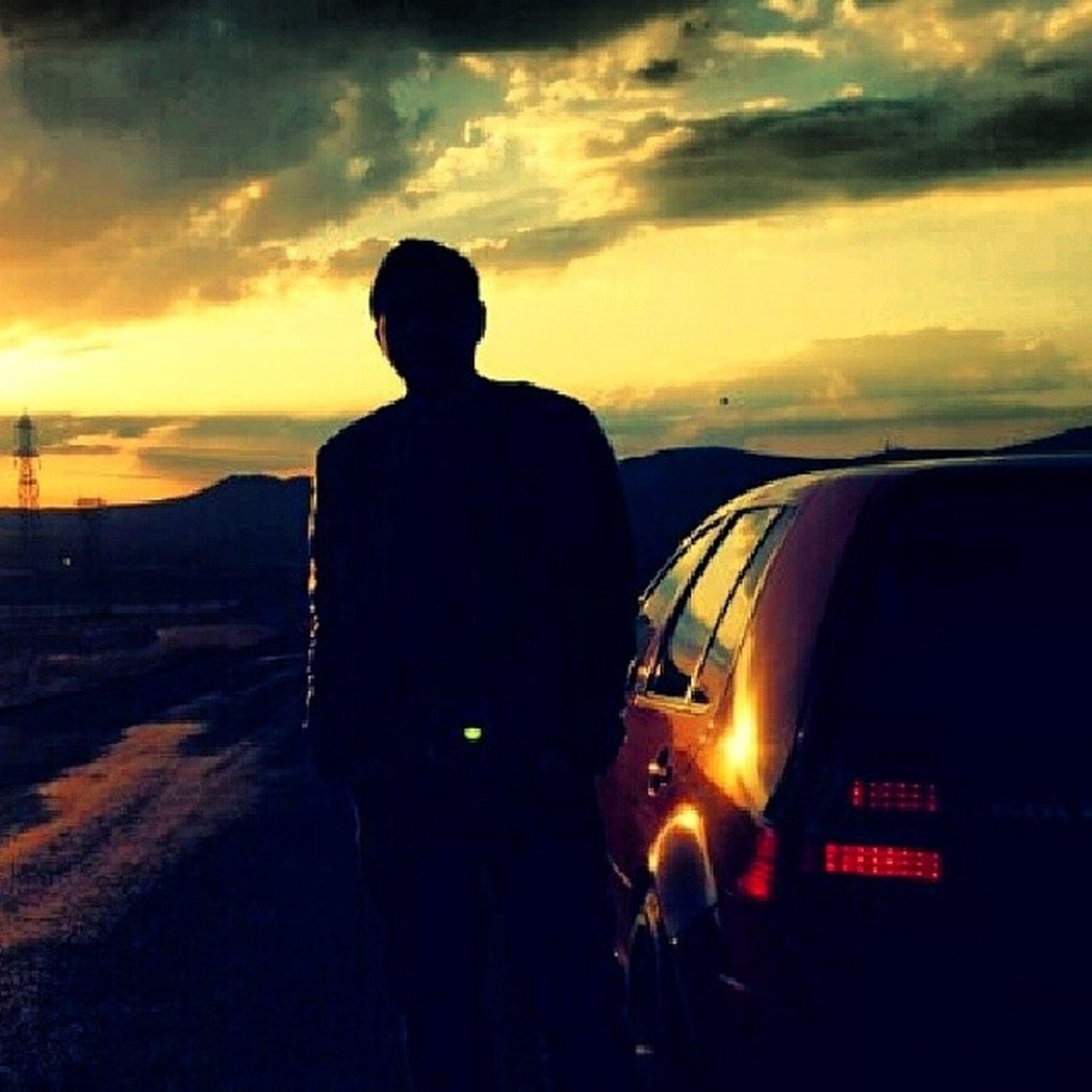 sunset, silhouette, sky, men, lifestyles, cloud - sky, orange color, leisure activity, standing, mountain, rear view, person, cloud, beauty in nature, dusk, scenics, nature