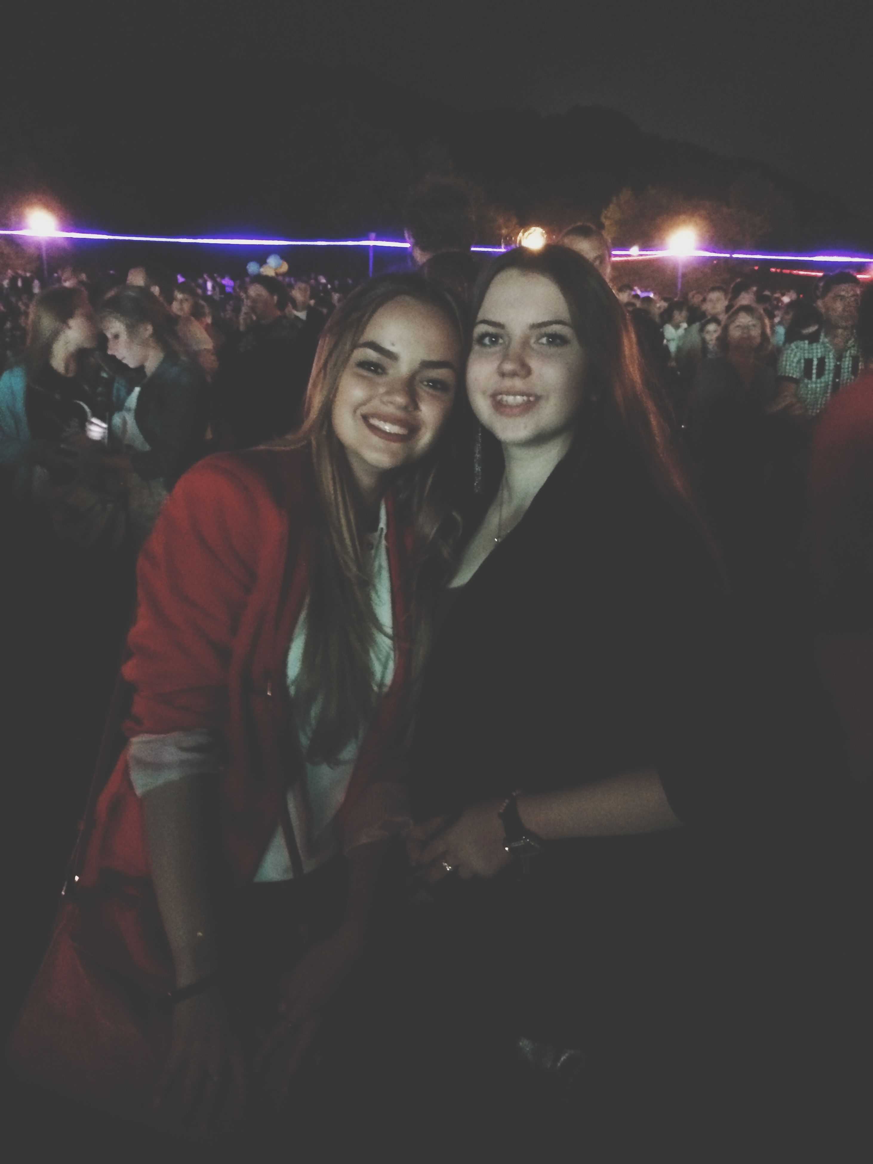 night, illuminated, lifestyles, leisure activity, young adult, portrait, standing, celebration, front view, happiness, casual clothing, looking at camera, togetherness, enjoyment, person, young women, fun, smiling