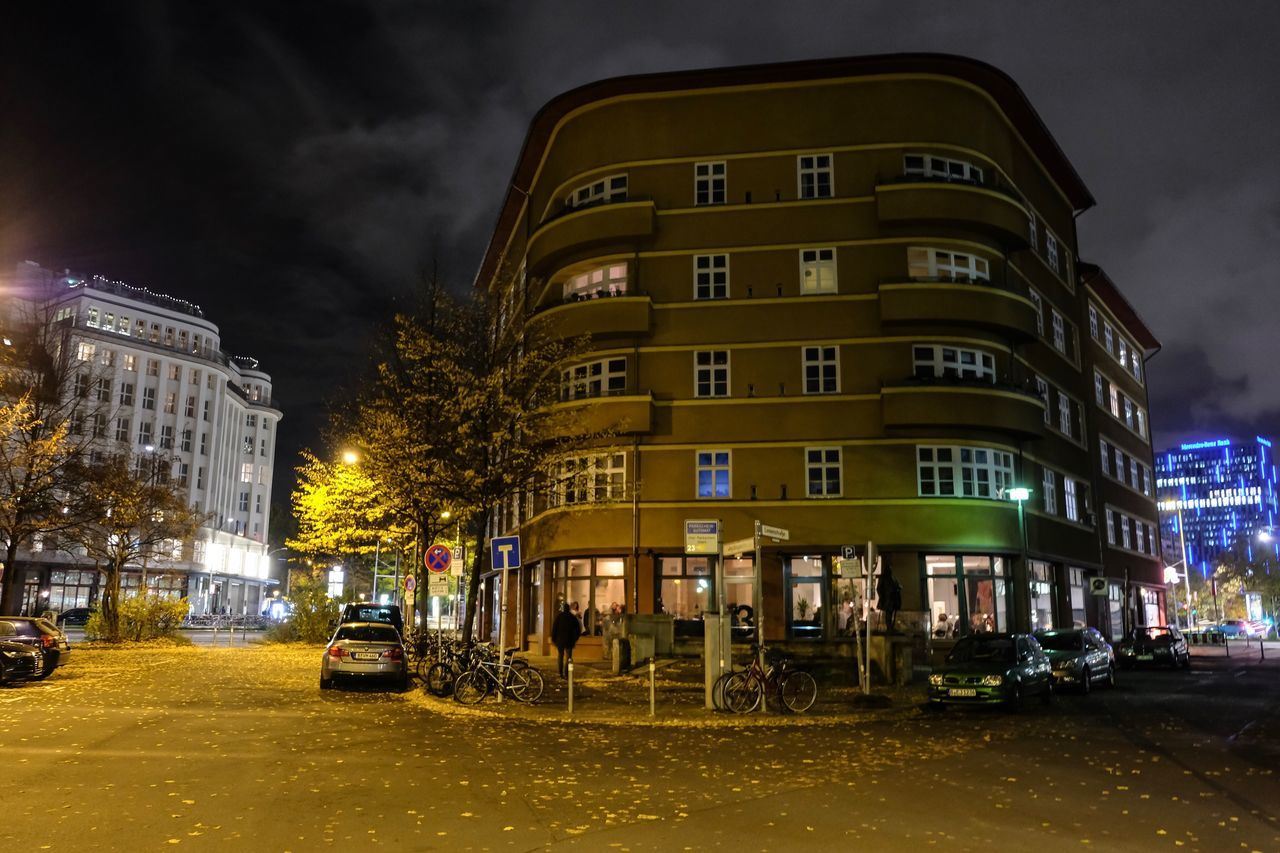architecture, building exterior, built structure, night, car, sky, illuminated, cloud - sky, street, transportation, city, no people, land vehicle, outdoors, residential building