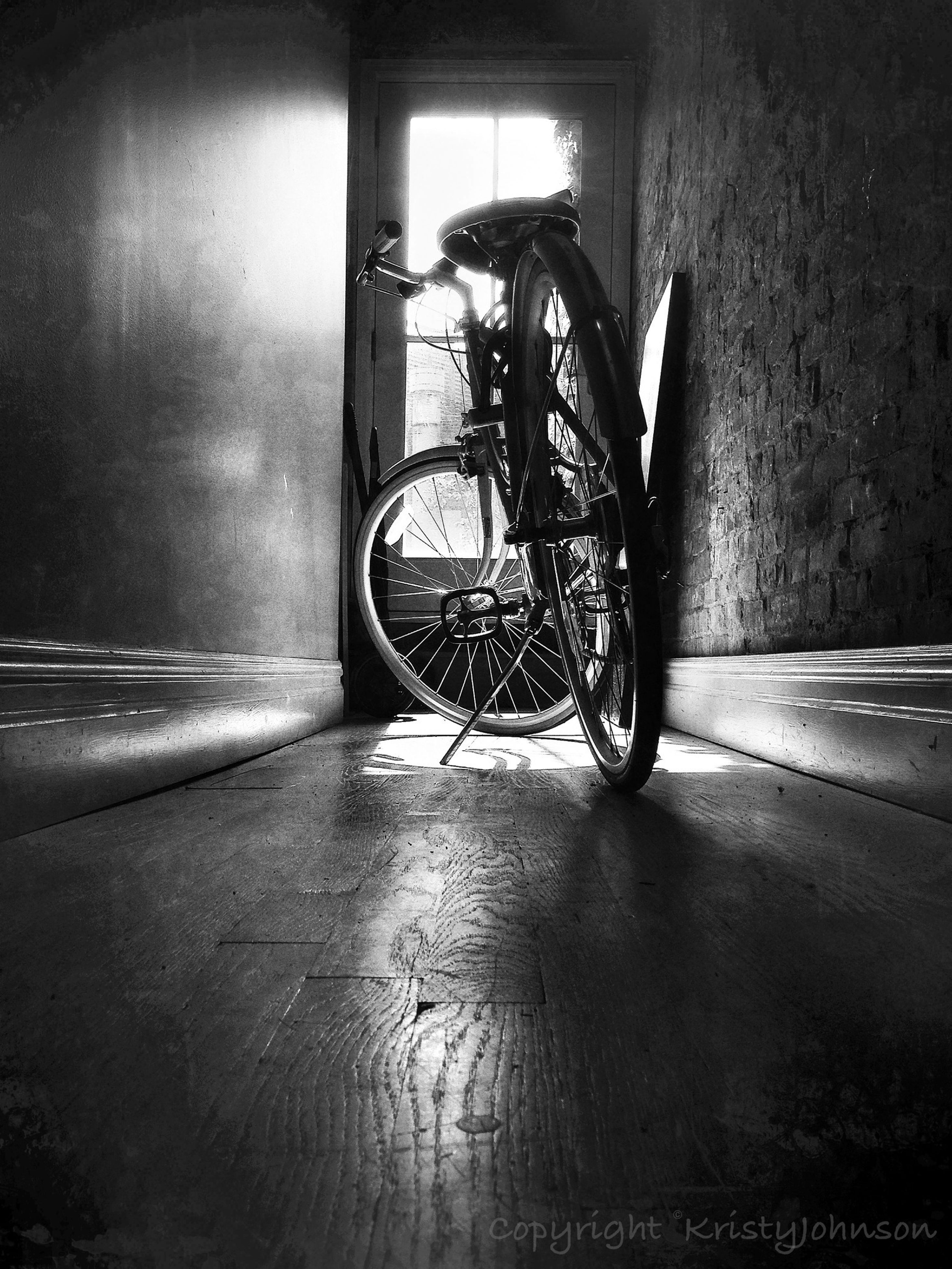 bicycle, transportation, mode of transport, land vehicle, stationary, built structure, parking, architecture, indoors, parked, street, wall - building feature, door, shadow, no people, day, sunlight, absence, window, wall