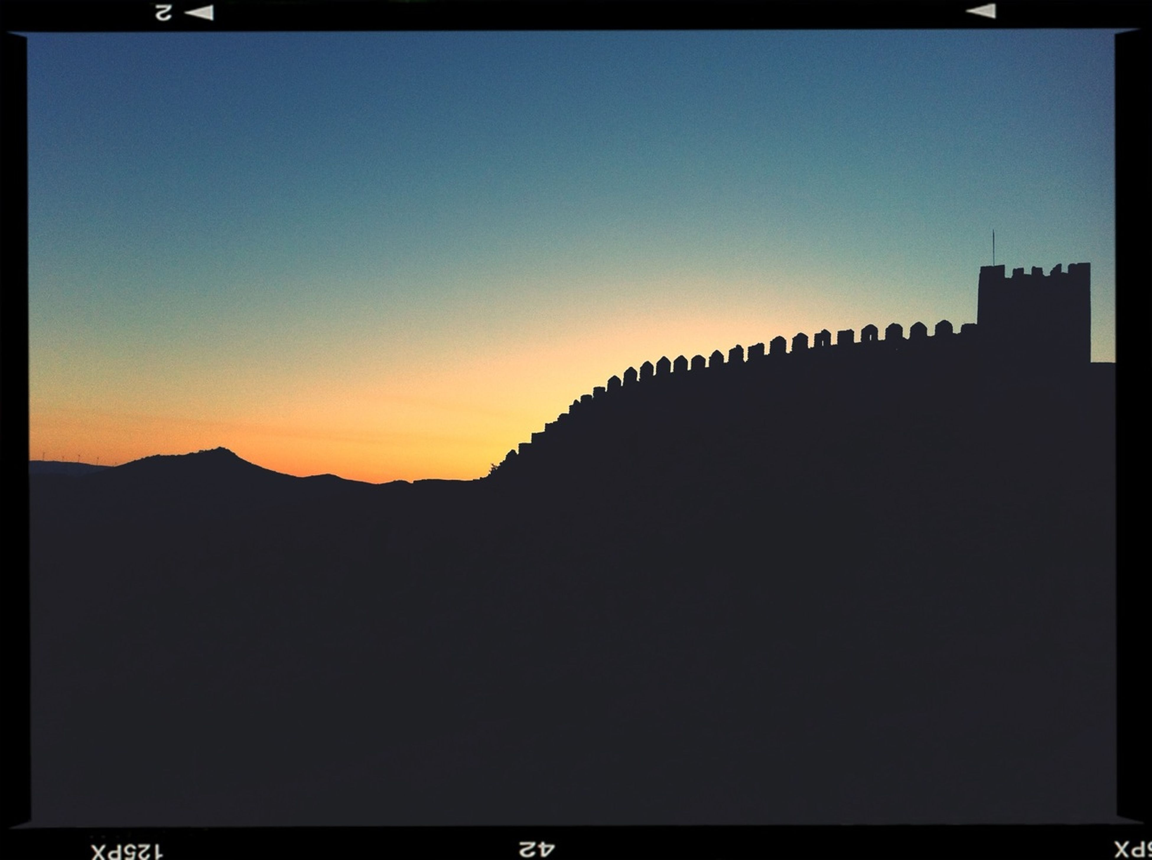 transfer print, sunset, silhouette, copy space, auto post production filter, clear sky, sky, scenics, beauty in nature, tranquil scene, built structure, tranquility, architecture, orange color, dusk, nature, outline, dark, building exterior, mountain