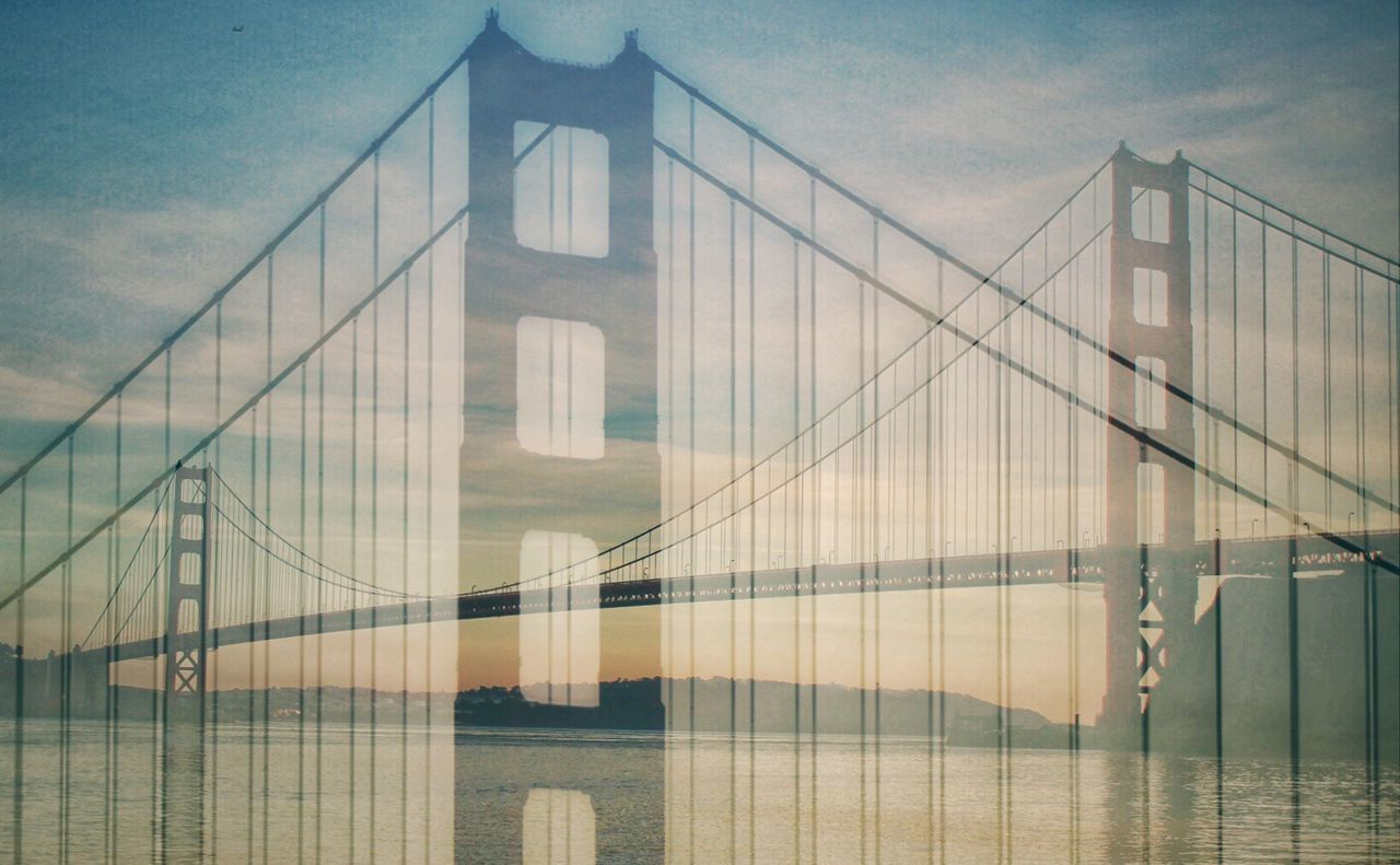 """My first attempt at """"Double Exposure"""" using 2 pics from a recent visit to the Golden Gate Bridge. I think it turned out pretty good!! Architecture Built Structure Sky No People Building Exterior Day Outdoors Connection Low Angle View Suspension Bridge Water Double Exposure Practice Photography Golden Gate Bridge California California Coast California Dreaming California USA Low Angle View Relaxing Taking Pictures Tranquility Waterfront Reflection Ocean View"""