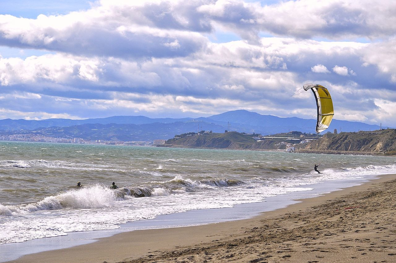 sea, beach, adventure, sky, water, nature, scenics, cloud - sky, day, outdoors, beauty in nature, extreme sports, real people, sand, mountain, sport, one person, vacations, wave, paragliding, parachute, people