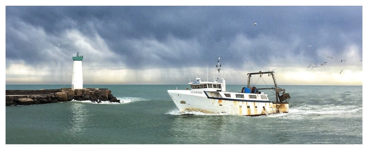 Fishing Boat Lighthouse Return To Port Storm Clouds Seagulls La Tamarissière Occitanie France