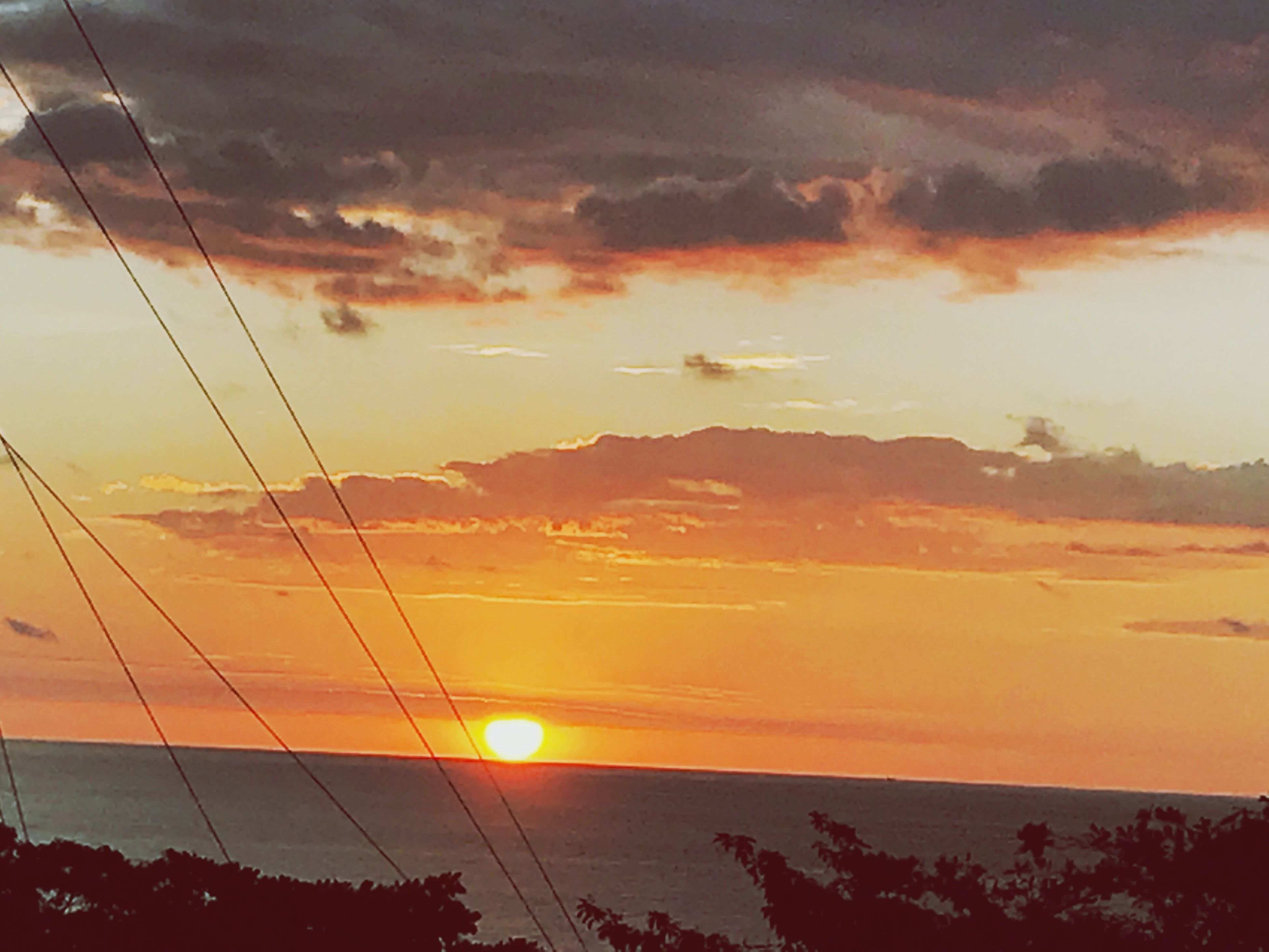 sunset, cloud - sky, sky, electricity, scenics, beauty in nature, power line, nature, no people, power supply, low angle view, cable, sunbeam, electricity pylon, outdoors, day