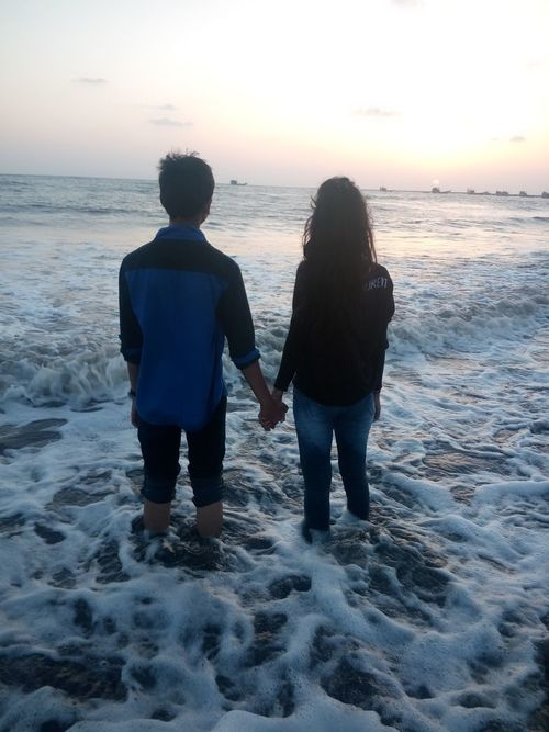 Couple Teenager Holding Hands Beach Sea And Sky Sea