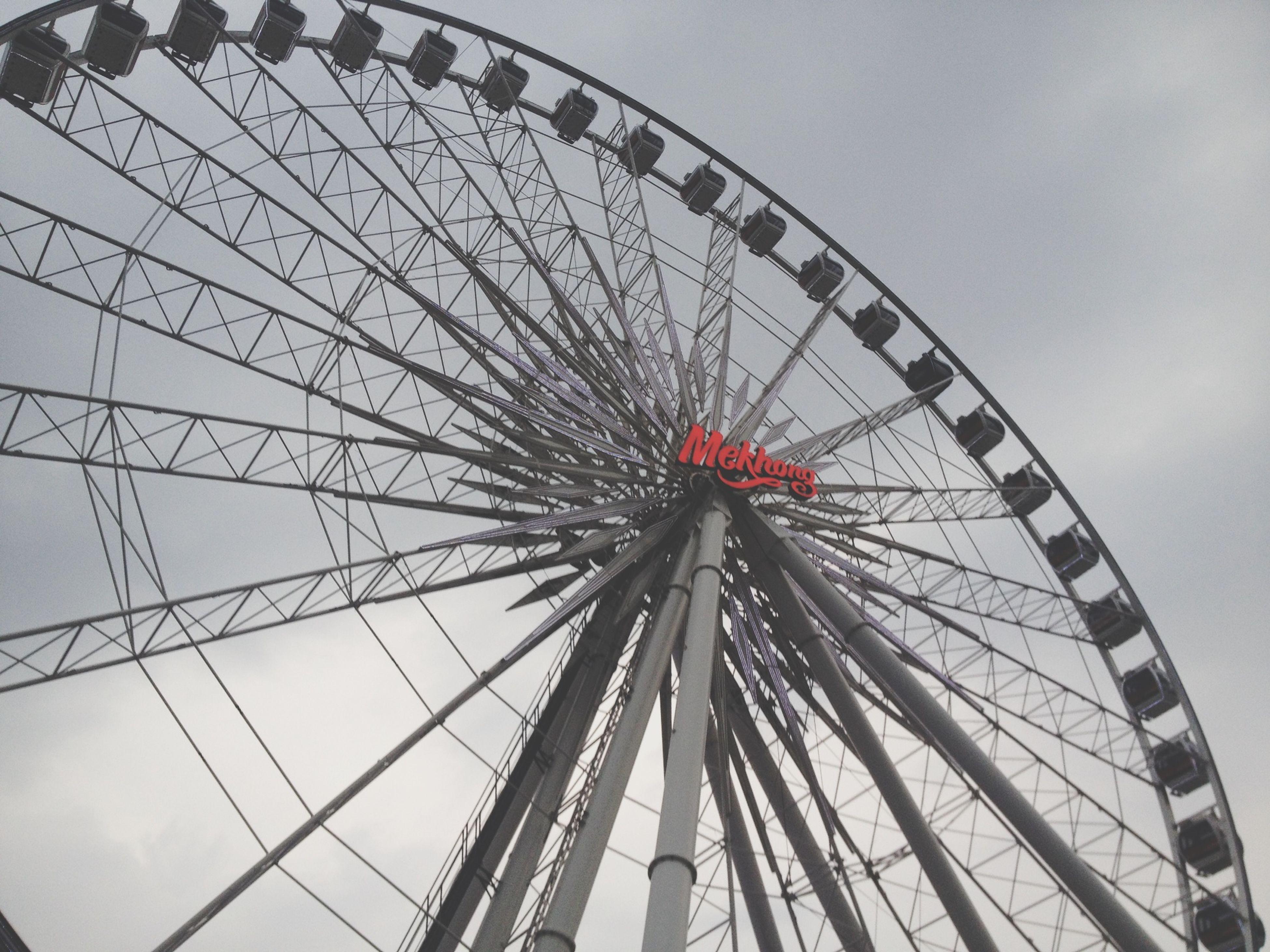 ferris wheel, amusement park ride, amusement park, arts culture and entertainment, low angle view, built structure, architecture, sky, metal, fairground, day, big wheel, large, outdoors, fun, fairground ride, no people, circle, travel destinations, rollercoaster