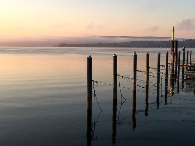 Water Wooden Post Tranquil Scene Scenics Tranquility Sea Sunset Idyllic Waterfront Sky Majestic Pole Travel Destinations Beauty In Nature Reflection Pier Nature Morning Calm Non-urban Scene