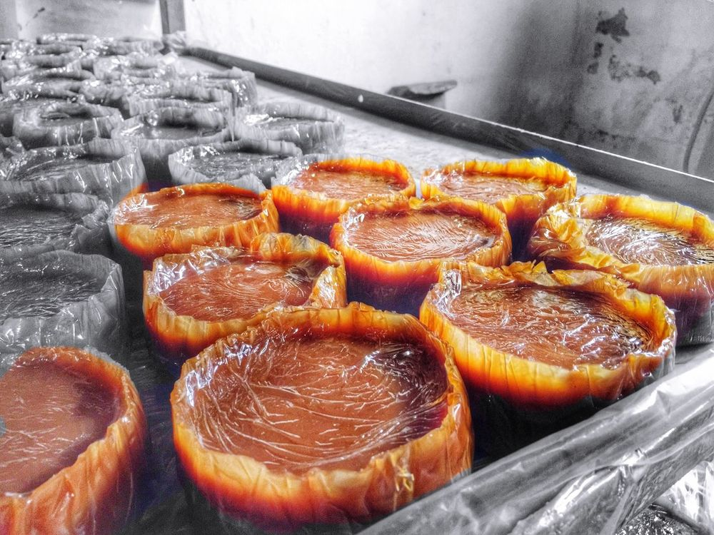 Kue Keranjang (Basket Cake), also called Nian Gao (年糕) or Tii Kwee (甜棵) in Hokkian, China, is a cake that is made from glutinous flour and sugar. It has an elastic and sticky texture. This kind of cake is prepared for Imlek celebrations (Kue keranjang was used as an offering to spirits, just before New Year (Jie Sie Siang Ang) until the day of Imlek. As an offering, this cake should not be eaten until Chap Goh Meh (15 days after Imlek). Chinese New Year Imlek
