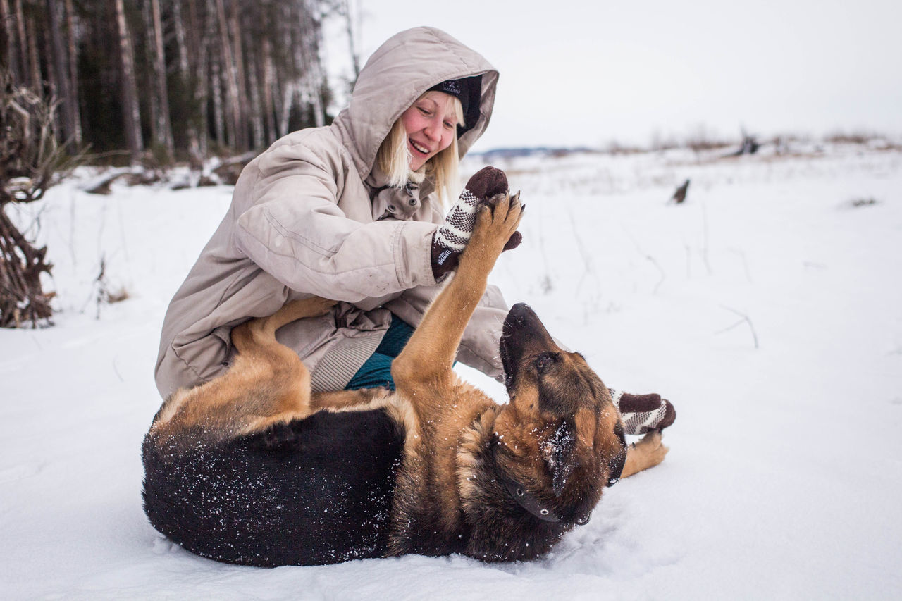 Bonding Cold Temperature Dog Enjoyment Freezing Friendship Frozen Happiness Home Ice Leisure Activity Lifestyles Outdoors Pets Smiling Snow Snowing Vacations Warm Clothing White White Album Winter Winter Young Adult Young Women