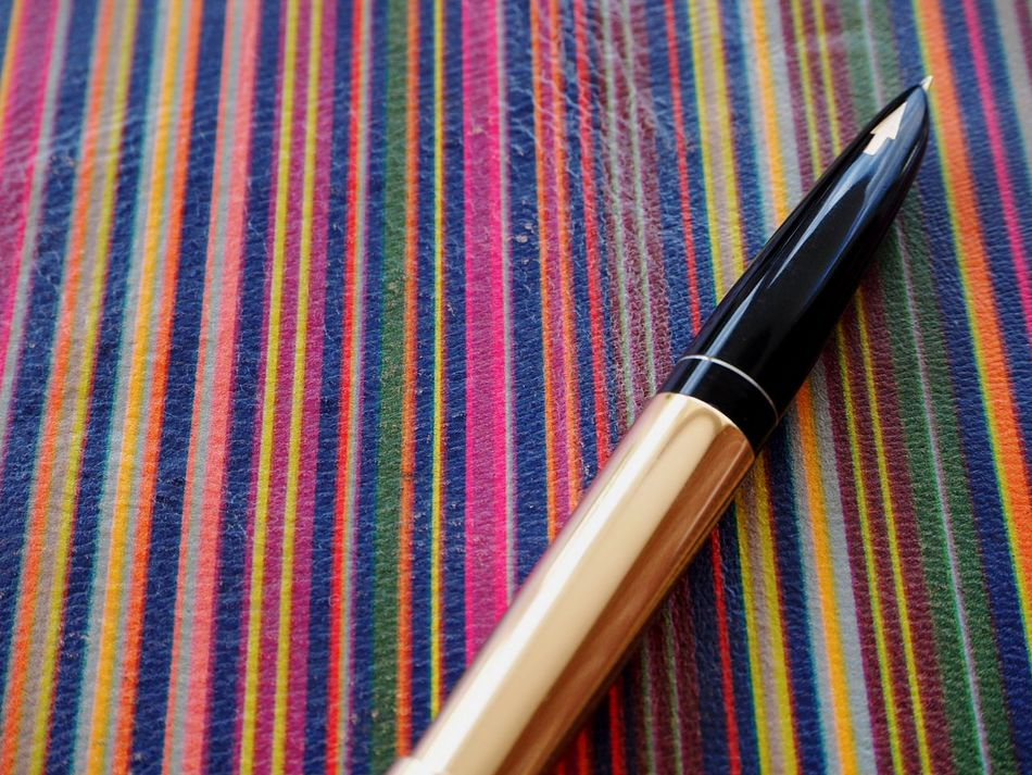 Pen Striped Close-up Retro Styled Old-fashioned Notebook Cover Writing Notebook Knowledge Knowledge Is Power Education Knowledge Is Freedom EyeEmNewHere Motivation Time To Study Pen Nib Pen Nibs Writing Instrument Golden Pen Arrow Symbol Neon Life Lines And Patterns Lines, Colors & Textures Parallel Lines Mix Yourself A Good Time