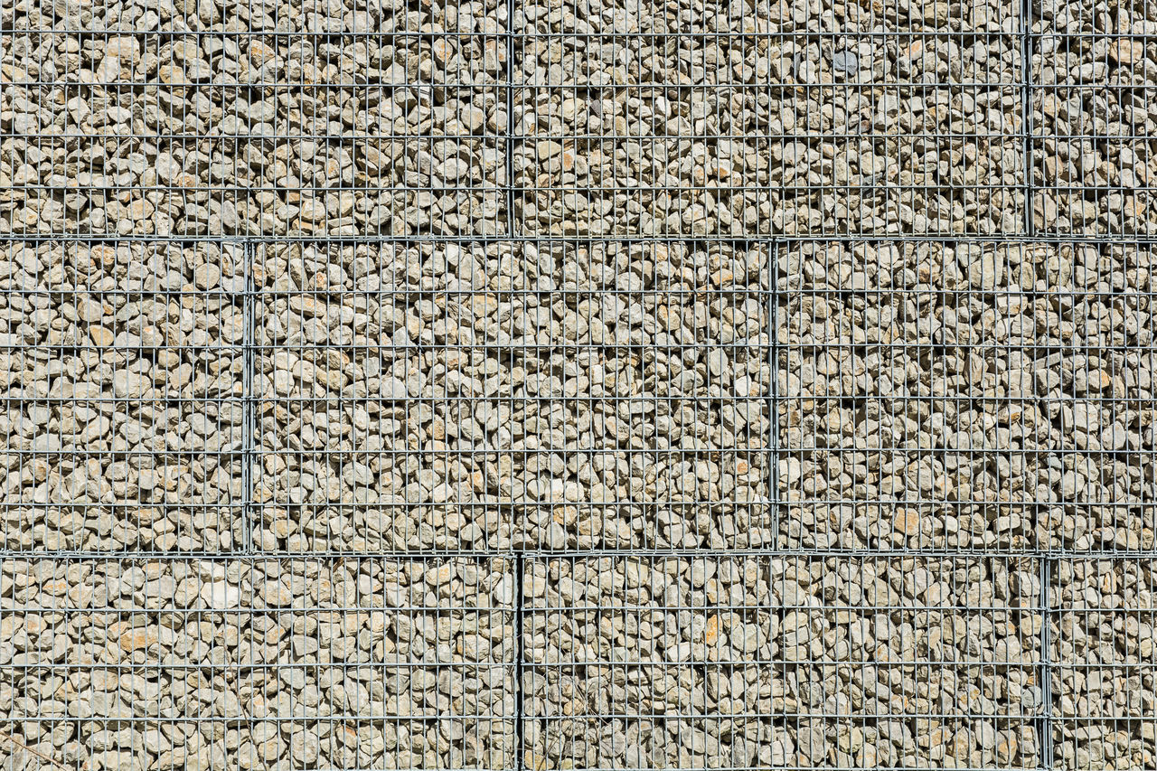 Backgrounds Close-up Day Flat Full Frame Grid No People Order Outdoors Pattern Protection Retaining Wall Safety Separation Stone Stone Wall Wall - Building Feature