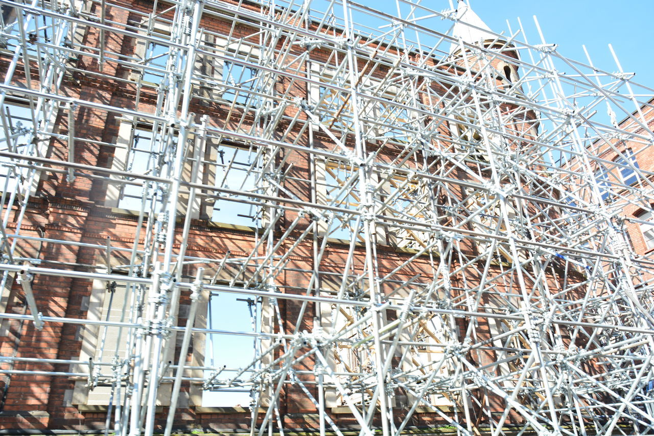 Architecture Building Exterior Built Structure Construction Construction Site Day Development Incomplete Industry Low Angle View No People Outdoors Scaffolding Sky