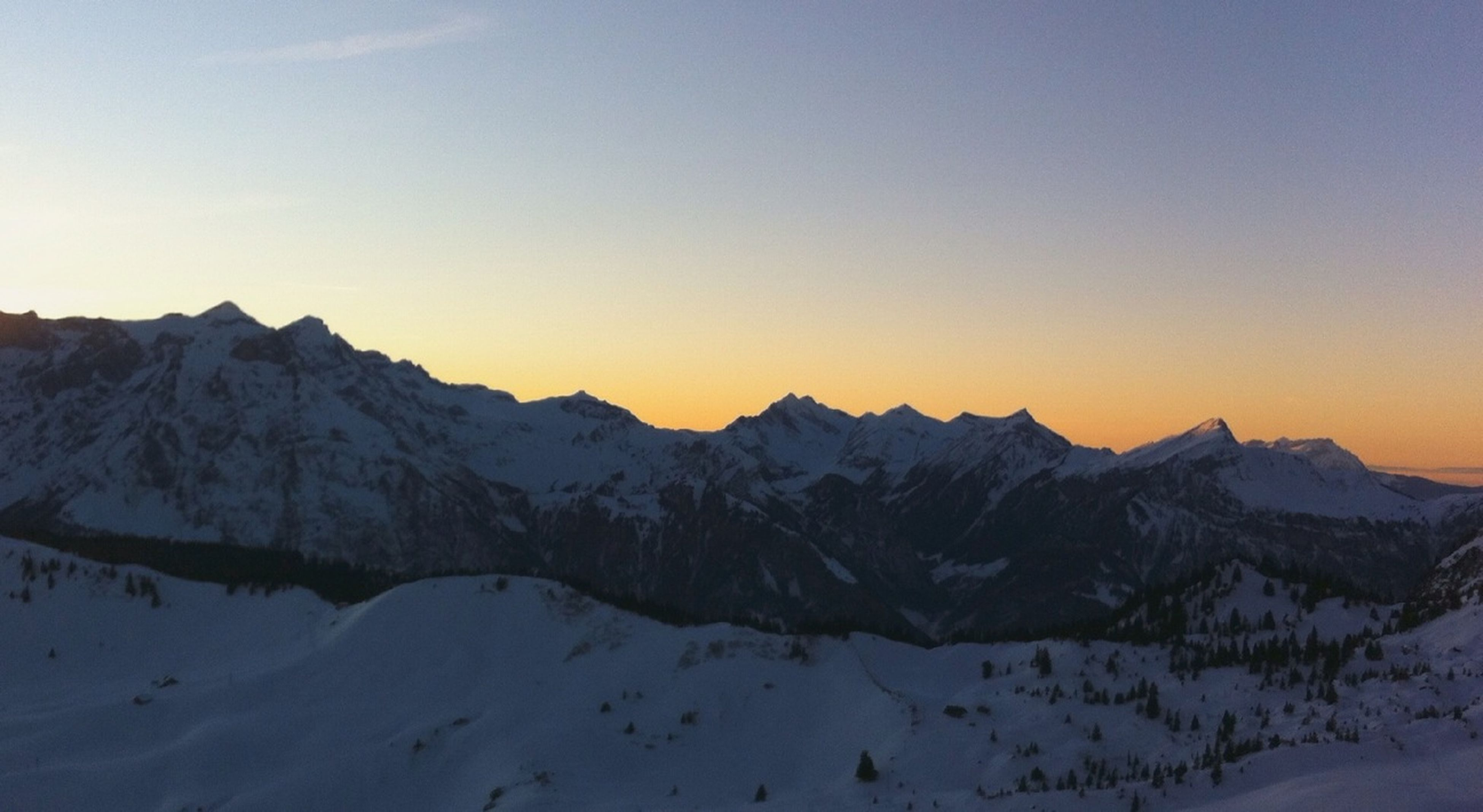 snow, winter, cold temperature, mountain, tranquil scene, scenics, season, tranquility, beauty in nature, mountain range, clear sky, sunset, landscape, snowcapped mountain, nature, weather, copy space, covering, non-urban scene, idyllic
