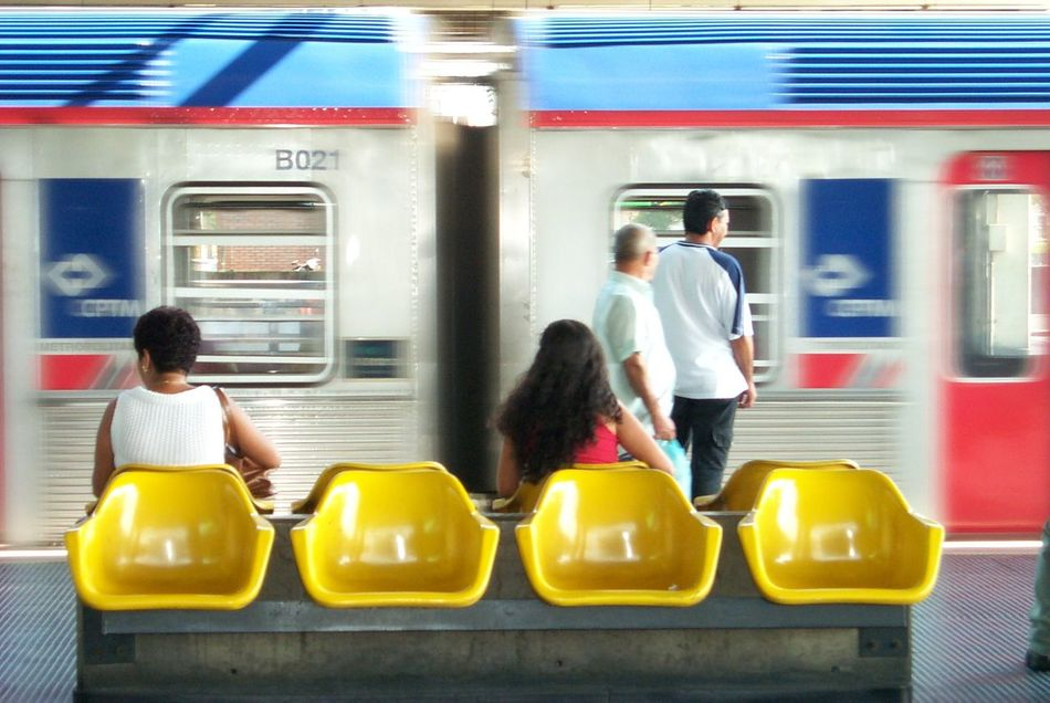 Adult Adults Only Casual Clothing Commuter Commuter Train Day Men Mode Of Transport Outdoors People Public Transportation Rail Transportation Rear View Sitting Station Subway Station Subway Train Train - Vehicle Transportation Women Young Adult Young Women