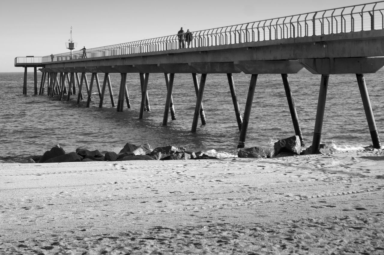 Architecture Badalona Beach Bridge - Man Made Structure Built Structure Clear Sky Connection Day Horizon Over Water Nature No People Outdoors Pier Sand Sea Sky Water