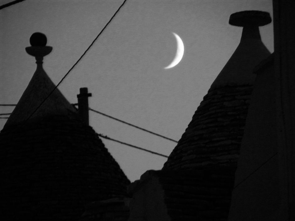 Alberobello Alberobello - Puglia Alberobello City Alberobellocity Alberobelloexperience Alberobellophotocontest Architecture Building Exterior Built Structure Cable Clear Sky Crescent Day Low Angle View Moon Nature No People Outdoors Religion Silhouette Sky