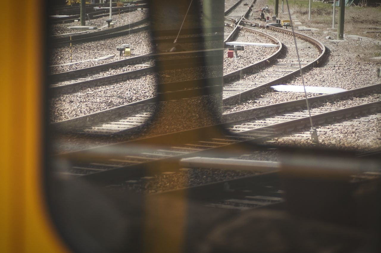 Tracks seen through a vintage train's cockpit. Looking To The Other Side Train Tracks Train Locomotive Public Transportation Reflection Urbanexploration Trainstation Deceptively Simple My Best Photo 2015 The City Light Minimalist Architecture