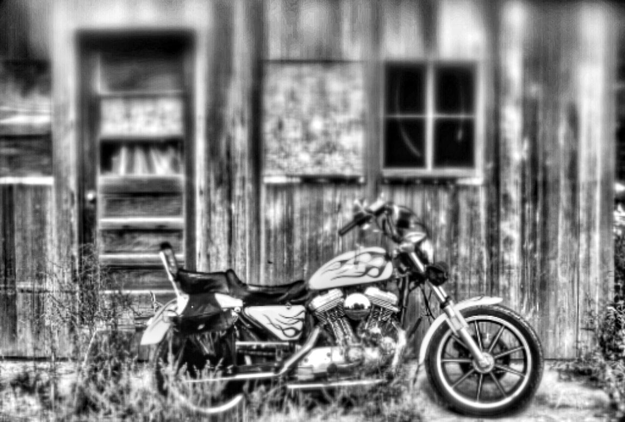transportation, mode of transport, stationary, day, outdoors, land vehicle, built structure, motorcycle, no people, architecture, building exterior