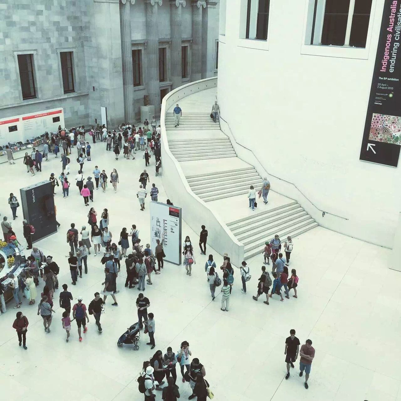 large group of people, high angle view, real people, architecture, building exterior, built structure, men, city, city life, public transportation, transportation, walking, lifestyles, women, rush hour, standing, crowd, day, indoors, people, adult