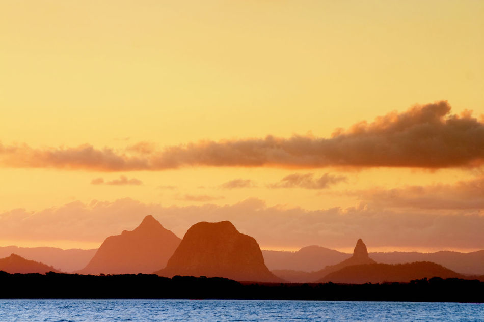 Beauty In Nature Glasshouse Mountains Landscape Mountain Mountain Range Nature No People Outdoors Scenics Silhouette Sky Sunrise Sunset Sunset_collection Water