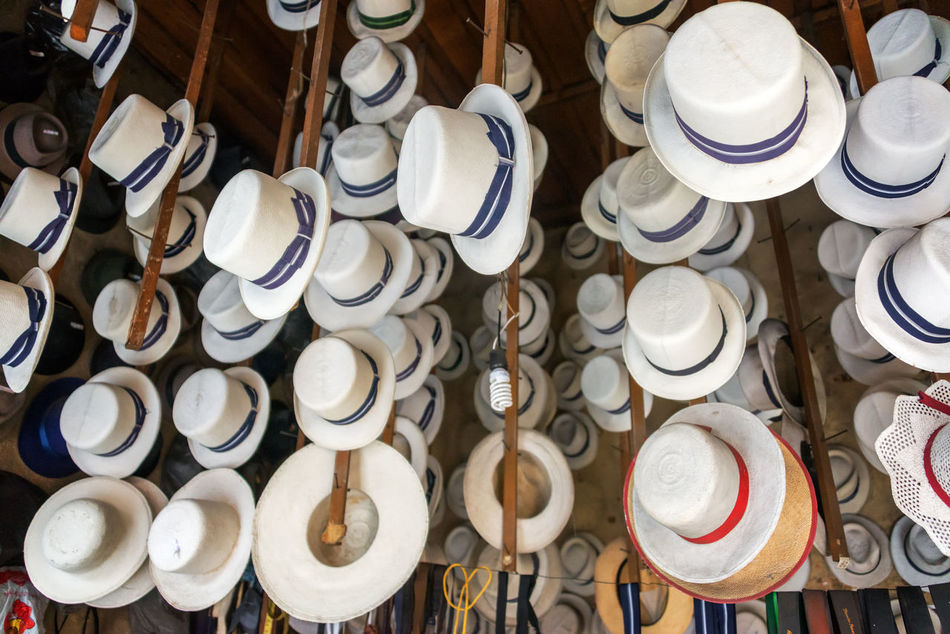 Traditional hats for sale in Cuenca, Ecuador Clothing Ecuador Handmade Hat Hats Indoors  Large Group Of Objects Latin America Market No People Panama Hat Panama Hats Panamá Retail  South America Straw Tourism Traditional Travel Travel Destinations White