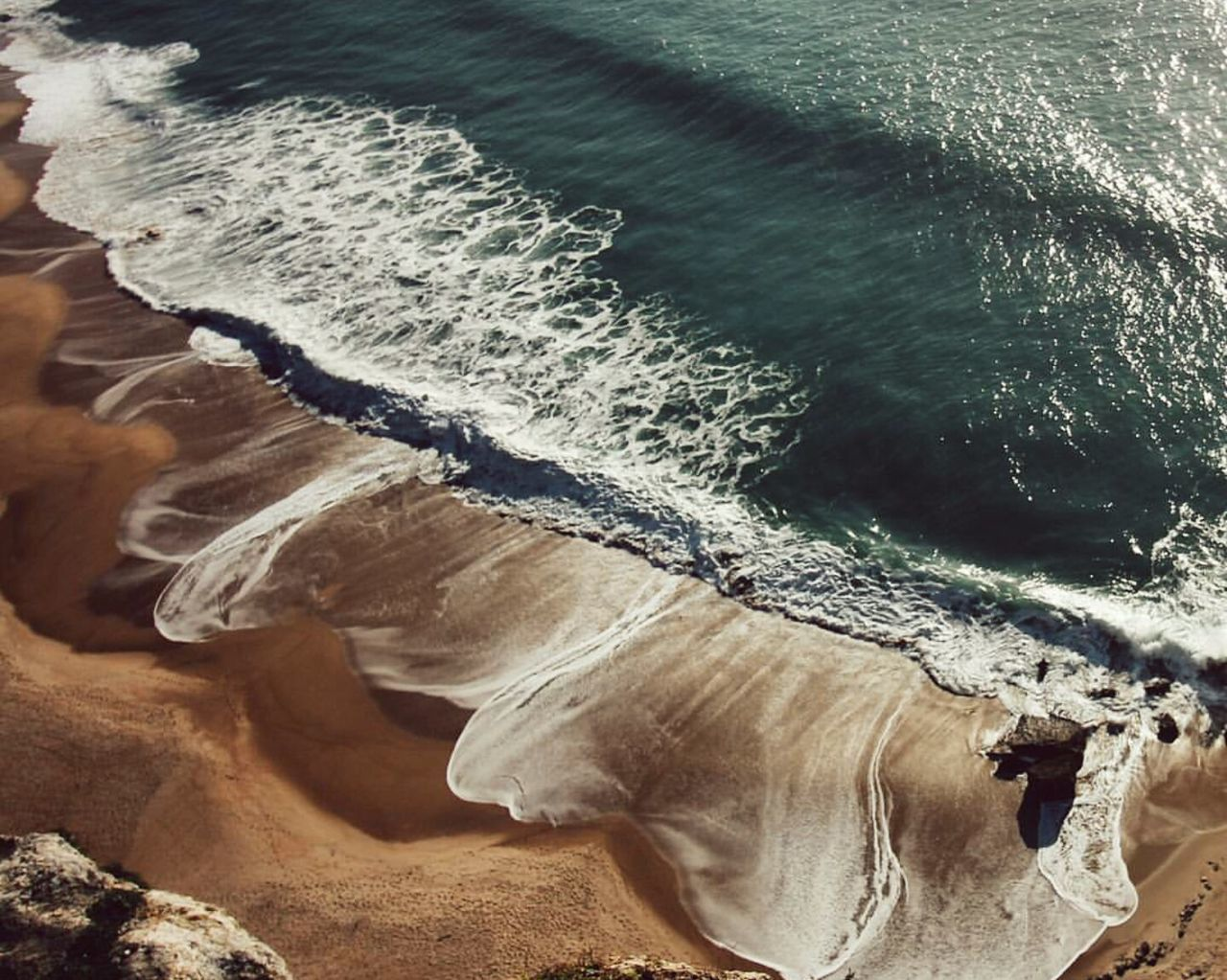 Beach at nazarè - Portugal. Sea Beach No People Outdoors Water Day Highquality Like4like Zoom Beautiful Nature Beautiful Freshness Iced Ice Amazing Plant Perfect Beauty In Nature Nature Flower Fruits Morning New York City Travel Ocean