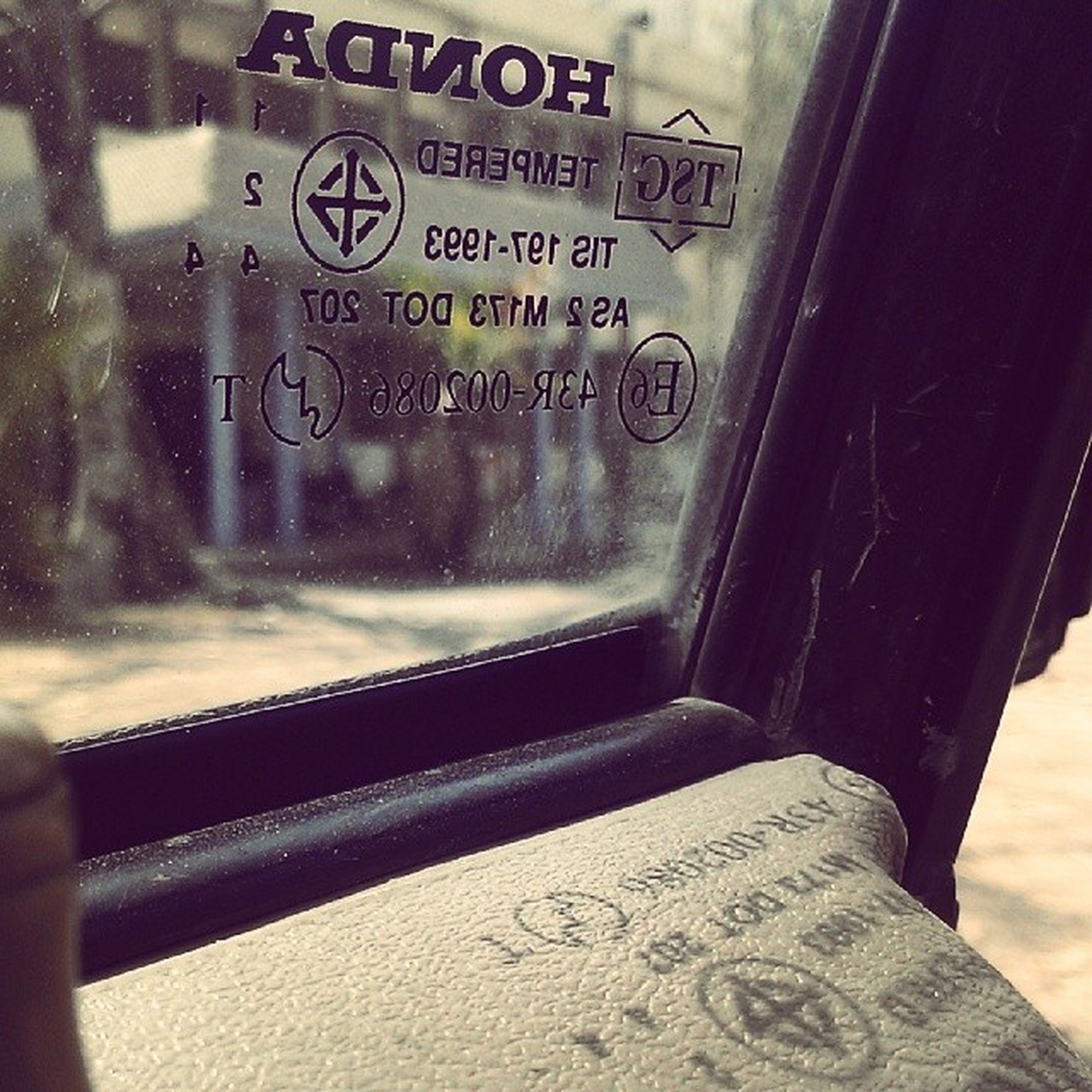 text, western script, communication, glass - material, close-up, transparent, indoors, focus on foreground, motion, non-western script, window, transportation, day, water, vehicle interior, part of, selective focus, information, no people, capital letter