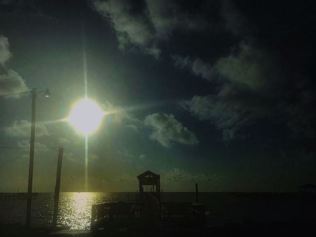 Sky Sun Cloud - Sky Water Sea Sunbeam Tranquility Lens Flare Sunlight Beauty In Nature Nature Scenics Tranquil Scene Horizon Over Water No People Outdoors Sunset Built Structure Beach Day Eclipse Of The Sun Eclipse2017 Rockport Texas Before Hurricane Harvey