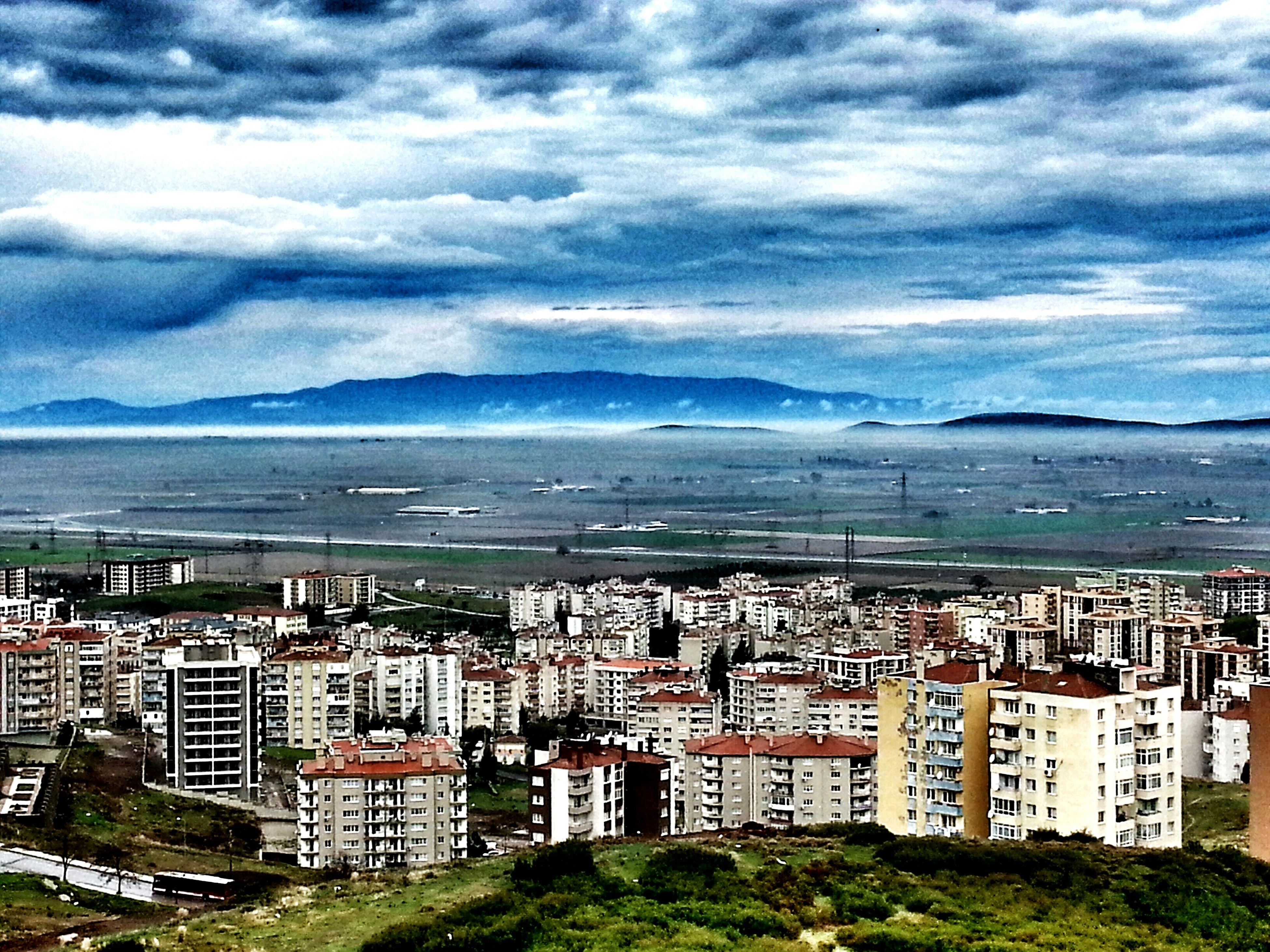 sky, cloud - sky, building exterior, architecture, cloudy, city, built structure, cityscape, water, sea, cloud, high angle view, residential district, residential building, scenics, weather, crowded, nature, beach, outdoors