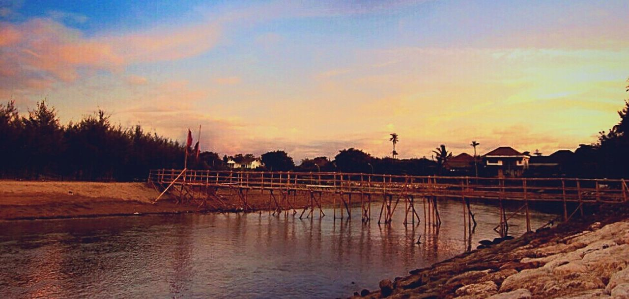 sunset, water, built structure, architecture, sky, cloud - sky, outdoors, no people, beauty in nature, nature, building exterior, tree, scenics, travel destinations, day, windmill
