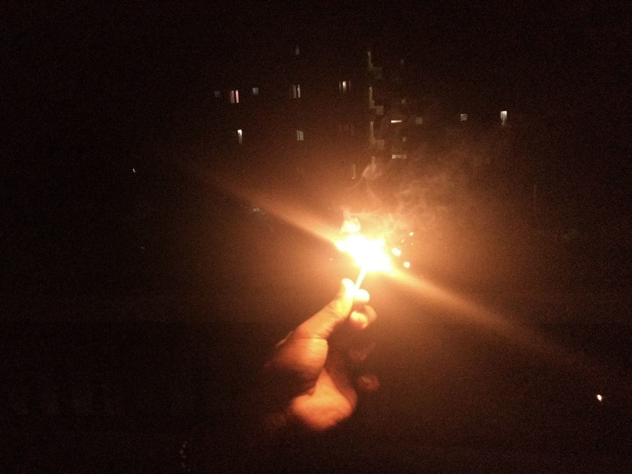illuminated, real people, night, one person, leisure activity, human hand, lifestyles, outdoors, men, close-up, people