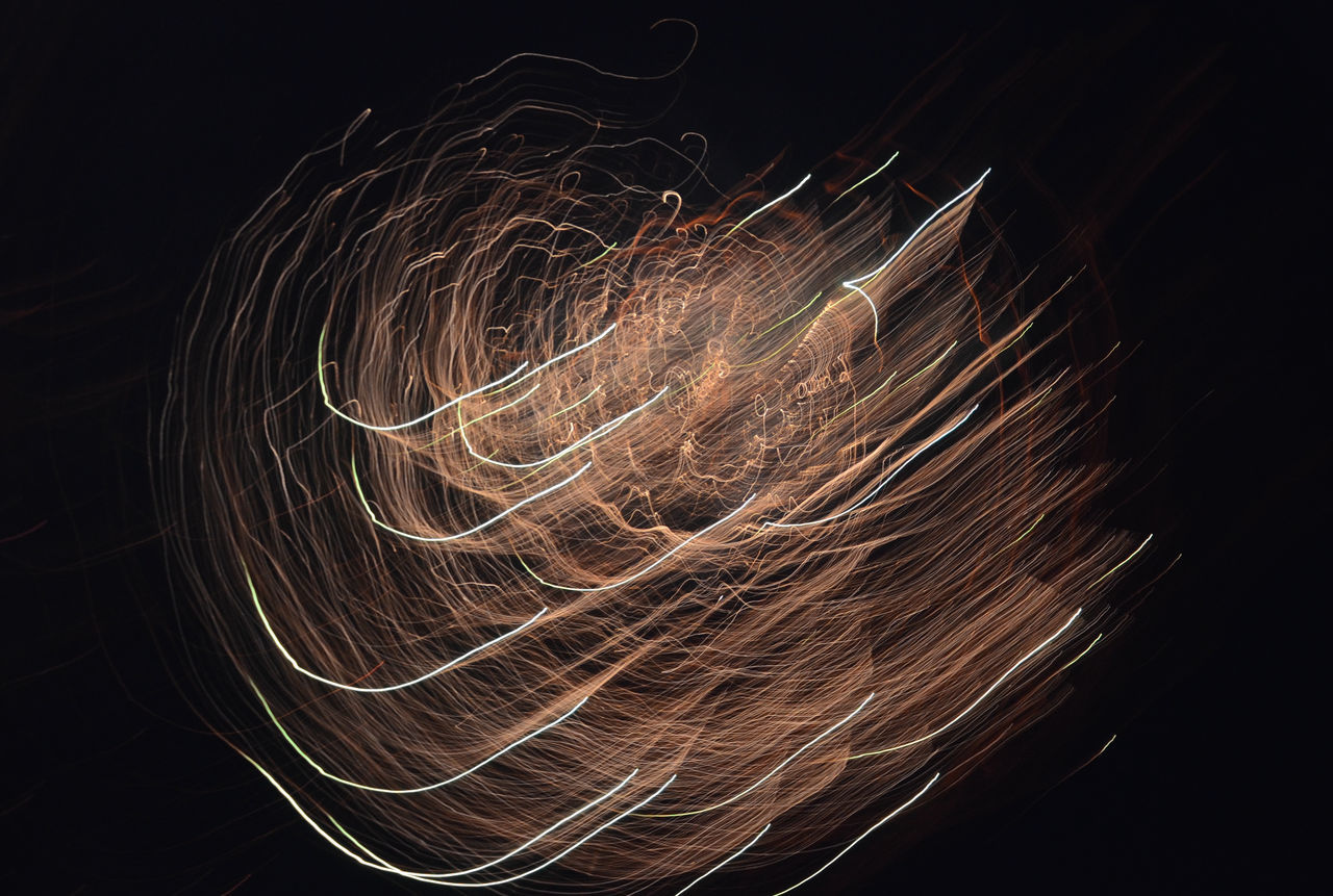 long exposure, light painting, motion, night, light trail, glowing, black background, illuminated, blurred motion, wire wool, speed, abstract, pattern, swirl, studio shot, no people, technology, close-up, outdoors, astronomy