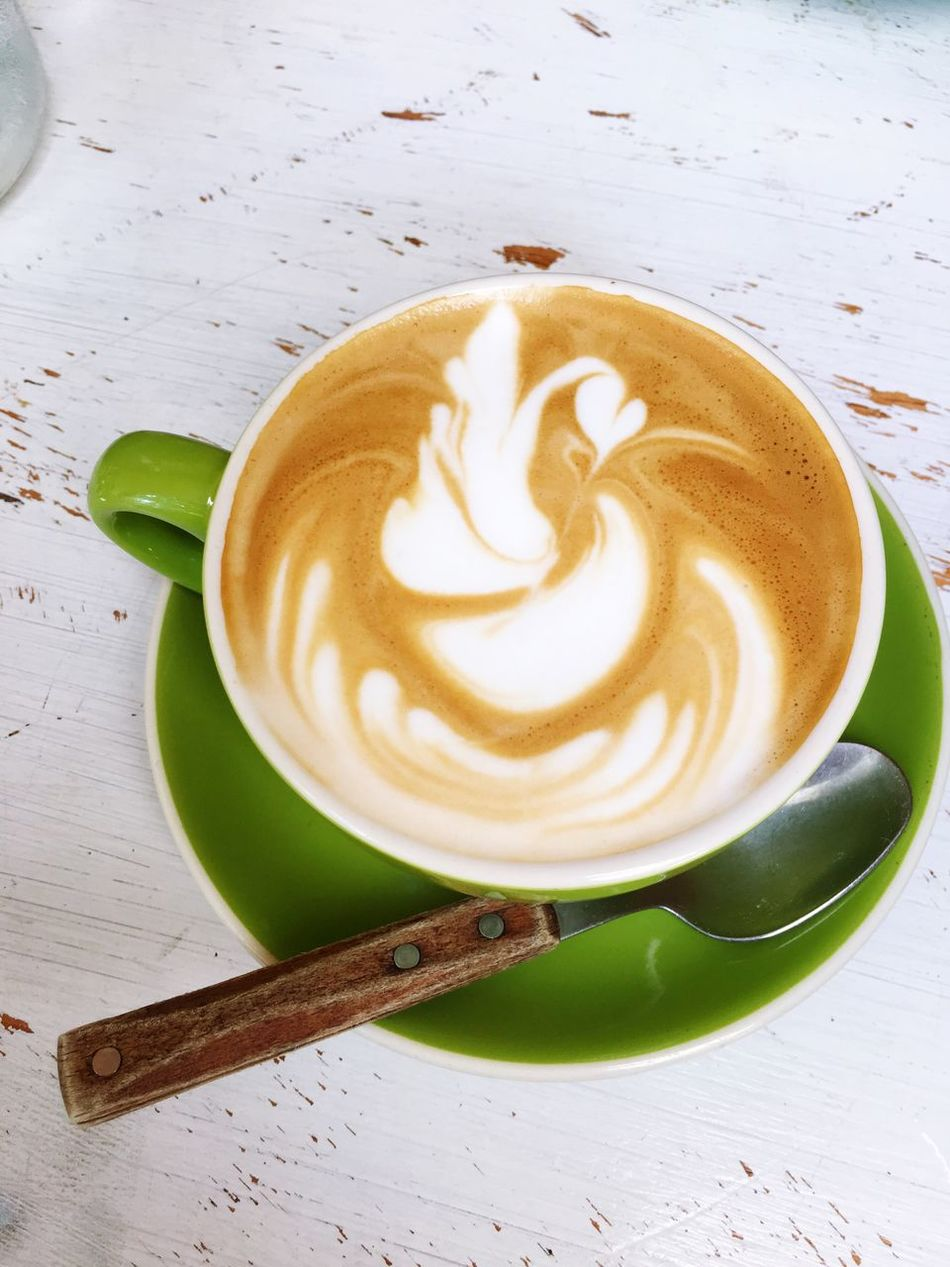 This coffee art looks like a swan! Coffee - Drink iCoffee Cup cDrink iRefreshment eCappuccino iFood And Drink iFroth Art aFrothy Drink iLatte tTable bLeaf eIndoors  oNo People pClose-up -Freshness eDay dCoffee Break eFlatwhite iFlatwhitecoffee fAustralia Coffee Time Coffee Art