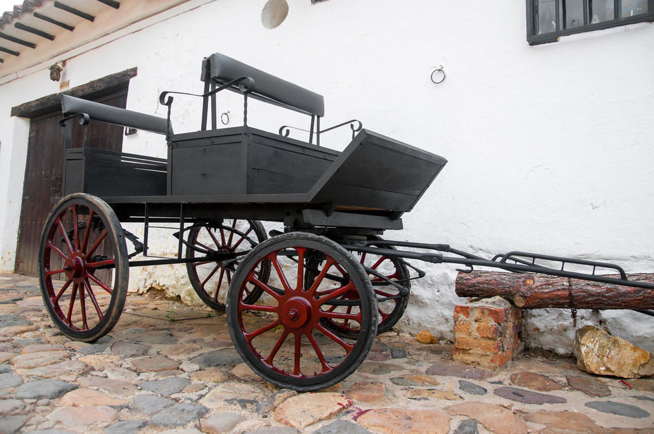 Old black wagon in small colonial town in Colombia Architecture Building Colombia Colonial Different Exterior Green Historic Home House Latin Old Outdoors Residence Size Stone Style Town Travel Typical Villa De Leyva  Wall Window Windows Wood