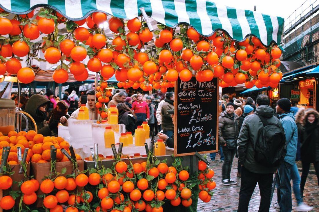 Orange juice stall in Camden London Vscocam Vcso Canon500d Streetphotography Everyday Life Lofi Market Orange Pantone Camden Town Fruit