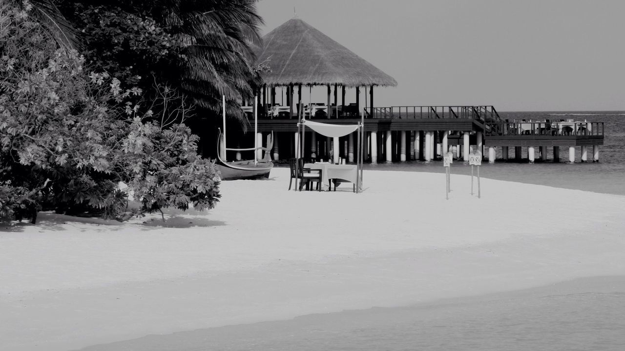 On the beach, Maldives Beach Built Structure Thatched Roof Sea Sand Architecture Water Tourist Resort Outdoors Stilt House Watervillage Maldives Take Your Place Holiday Black And White Nature Beauty In Nature Light Impression Lifestyles Architecture Travel Summer Life Is A Beach Life
