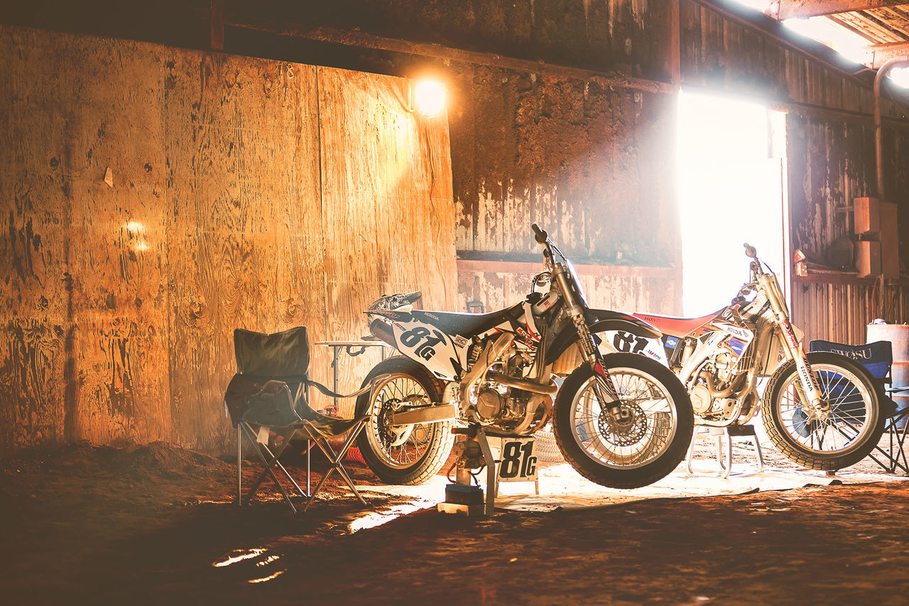Cold Temperature Dusk Dust Dusty Flat Flattrack Illuminated Light Light And Shadow Mode Of Transport Motorcycle Motorcycles No People Pits Race Stationary Sun Transportation