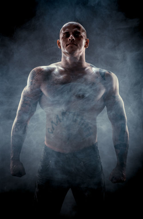 Silhouette of muscular man Athlete Athletic Caucasian Figure Gray Background Guy Handsome Man Muscle Muscular Muscular Build Muscular Man One Person Person Physique  Shaven Head Silhouette Smoke Sport Sportive Strength Strong Weight Young Adult