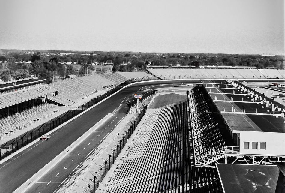 Empty Places Empty Racetrack Motorsport Grandstands Motorsports Indy Circuit Indianapolis  Travel Destinations Transportation Bridge - Man Made Structure Day Built Structure Architecture Outdoors Road Clear Sky Sky No People City