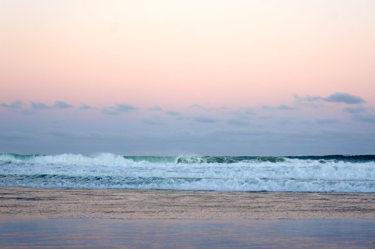 Beach Beauty In Nature Escapism Horizon Over Water Outdoors Sand Scenics Sea Seascape Shore Summer Sunset Sunset_collection Surf Tranquil Scene Tranquility Water Wave Weekend Activities