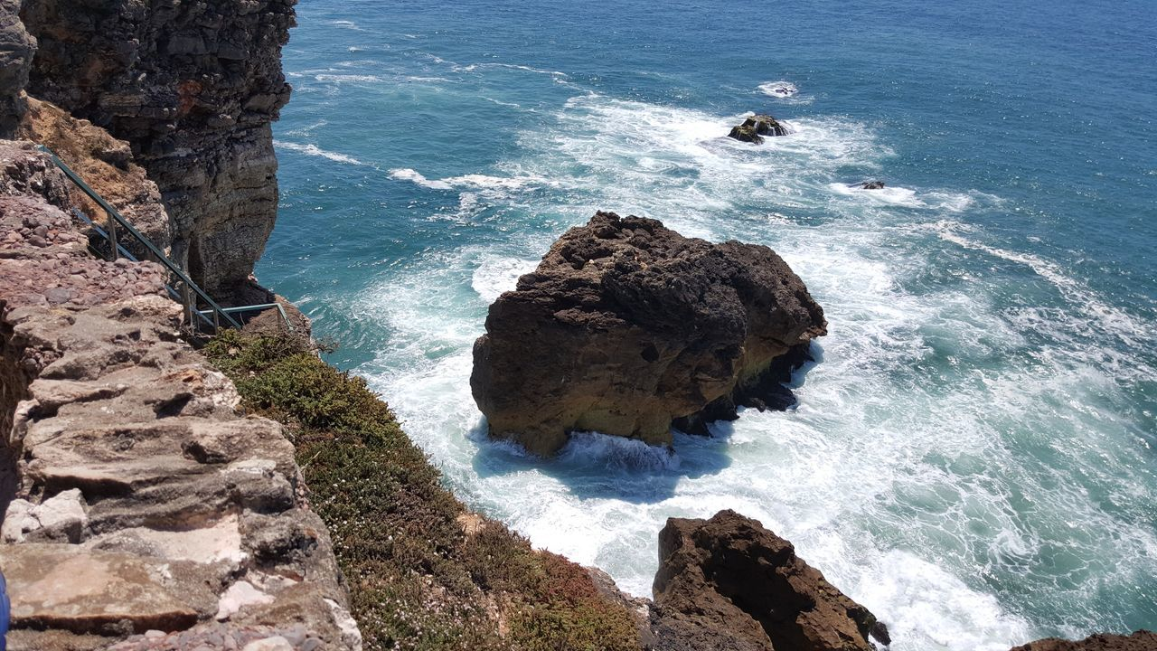 sea, rock - object, water, rock formation, high angle view, nature, beauty in nature, rock, wave, day, scenics, tranquil scene, cliff, tranquility, horizon over water, outdoors, motion, beach, no people