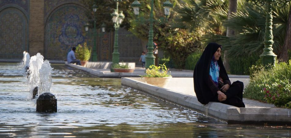 Beauty In Nature Day Fountain Golestan Palace Lifestyle Lifestyles Outdoors Park Public Transportation Water Woman Sitting Women Public Places The City Light Women Around The World