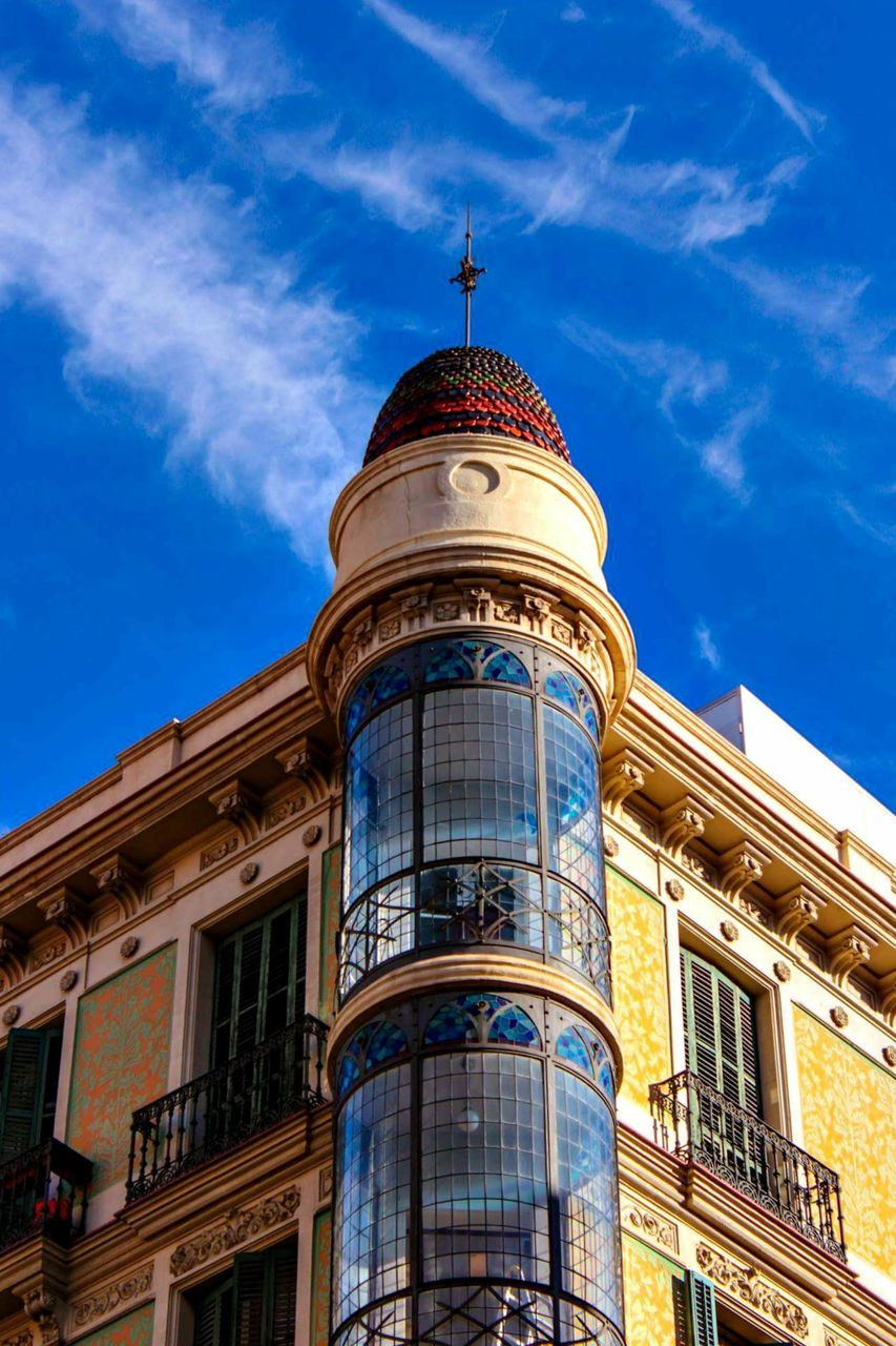 architecture, building exterior, built structure, low angle view, dome, outdoors, sky, no people, blue, day, city
