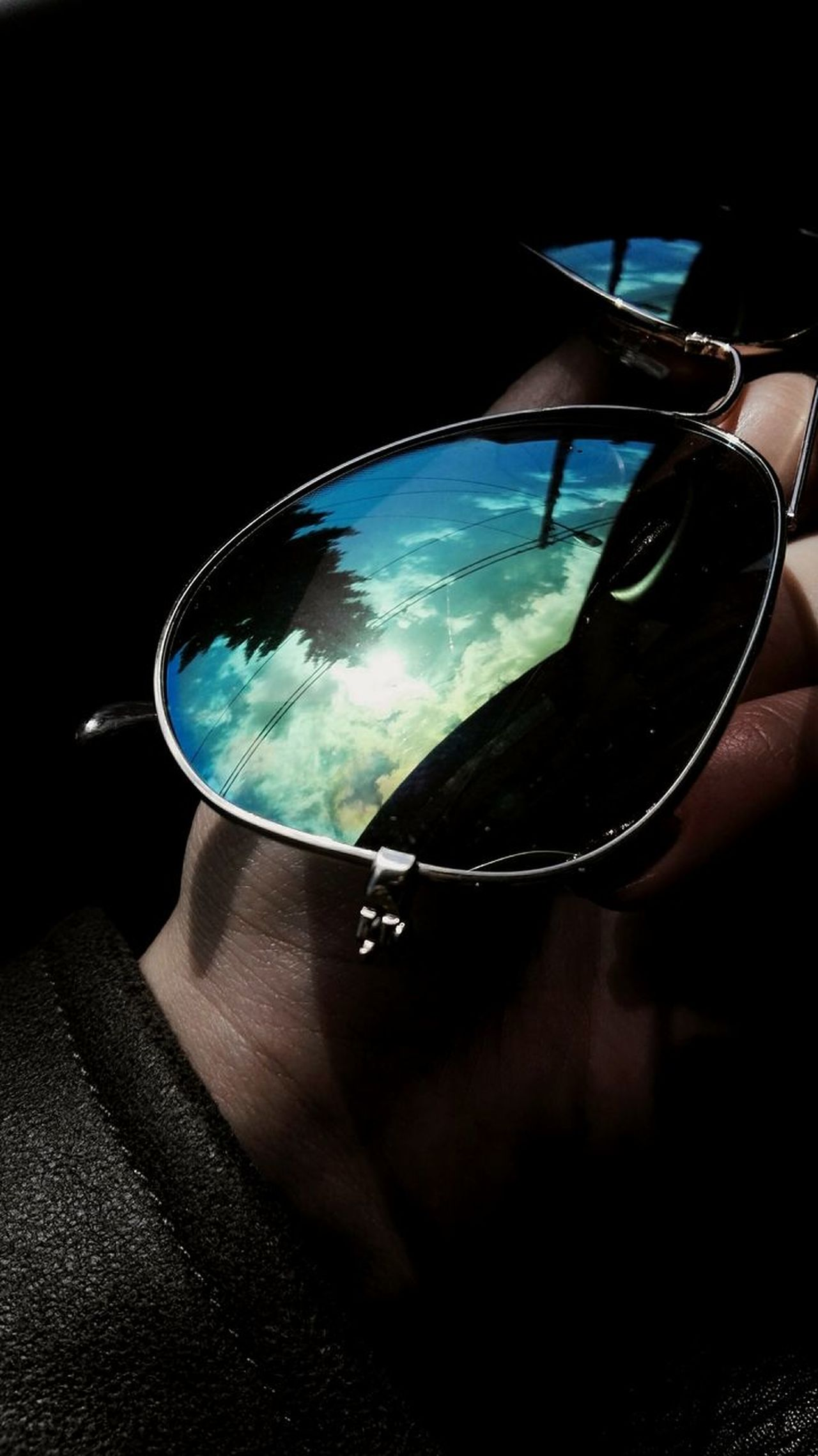 Reflection Glasses Glass Reflection Photography Black Background Close-up Shadow Contrast Colors Colorsplash Hand Human Body Part Human Hand Body Part No People Blue Sky Sky And Clouds Cloud - Sky Clouds And Sky Nature Tree Reflections And Shadows High Contrast Green Color