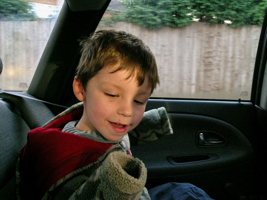 My son in the back of our car on the way to a book fair when he was young. Child Chlidhood Close-up Day Focus On Foreground Land Vehicle Leisure Activity MeinAutomoment Mode Of Transport Sitting Traveling Vehicle Interior