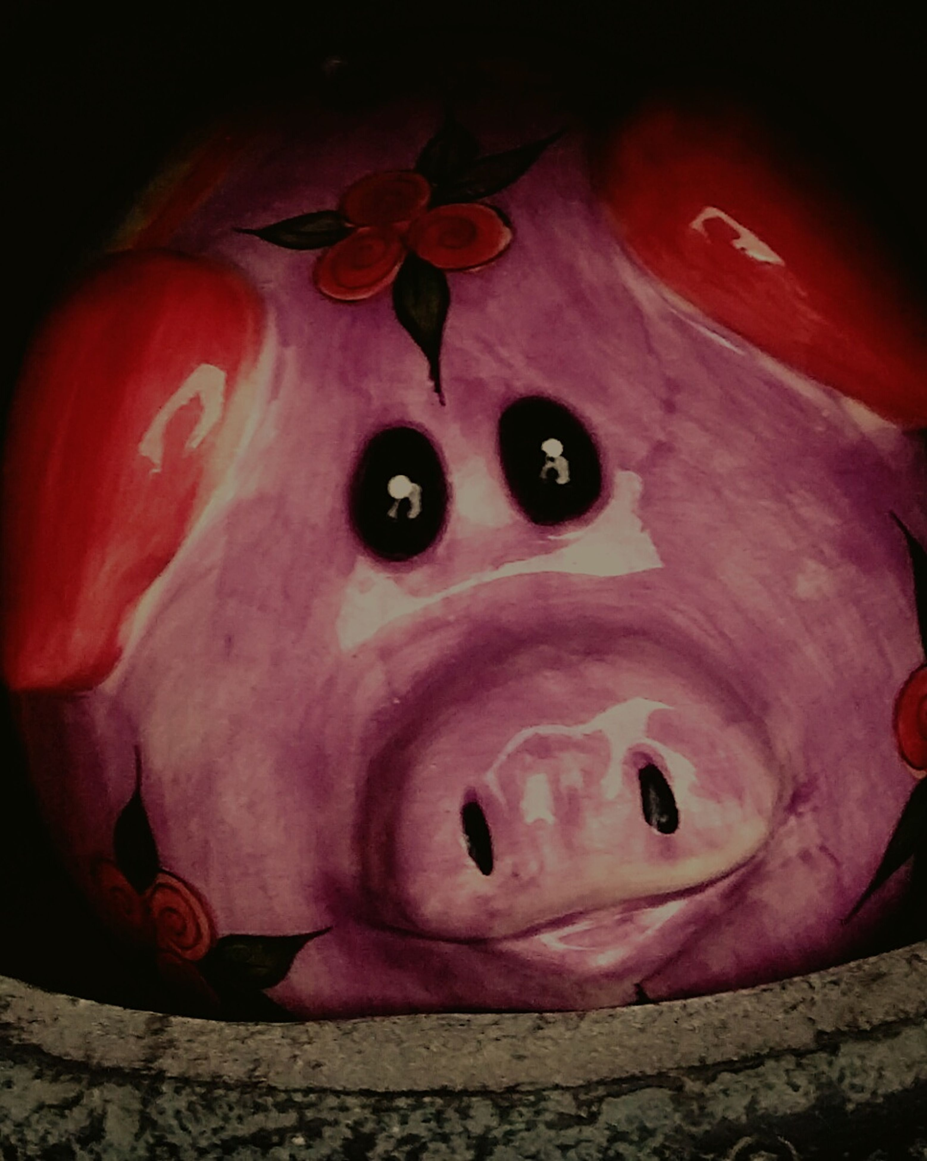 red, indoors, art and craft, art, creativity, close-up, high angle view, human representation, animal representation, anthropomorphic face, still life, no people, toy, pink color, halloween, single object, night, wall - building feature, craft, tradition
