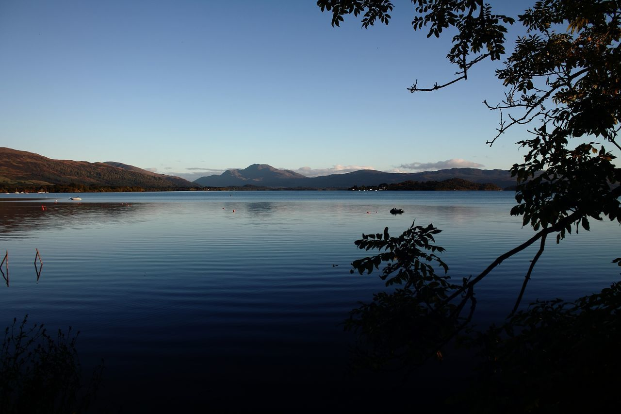 Photo is of Loch Lomond, taken with my Canon. Blue Day Lake Landscape Loch  Loch Lomond LochLomond Nature No People Outdoors Reflection Scenics Scotland Sky Sky And Clouds Tree Water