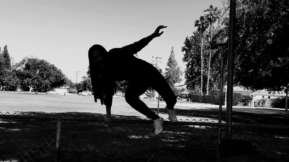Blackandwhite Amateurphotography Fence Blah Girl Hair Action Shot  Darkness And Light Face Mypointofview Trees Trees And Sky Grass Power Lines Houses Figure